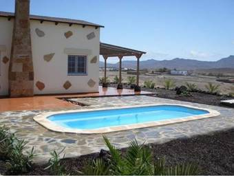 Hoteles en gran tarajal for Villas con piscina privada en fuerteventura